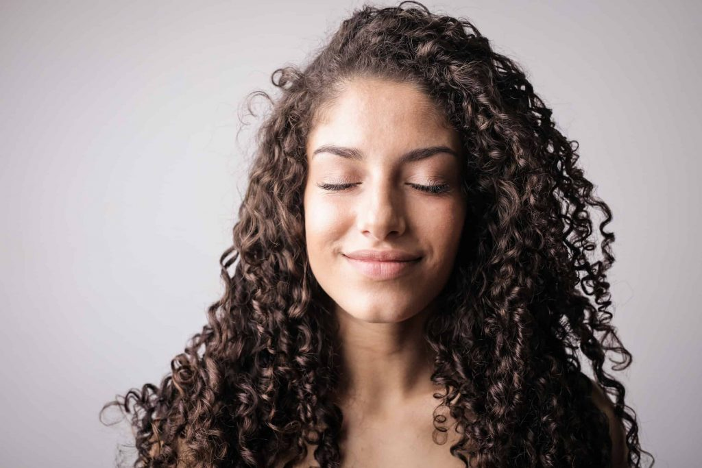 mindful woman mentally saying affirmations